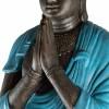 Estatua buda rezando con túnica turquesa
